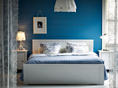 Room without a door...BRUSALI white bed with bedside tables and EMMIE LAND white/blue quilt cover and pillowcases
