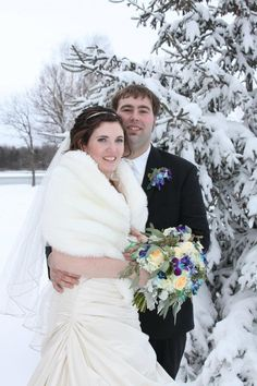 Silver, sapphire, and diamond pins within a wedding bouquet really looks fantastic in a winter wedding