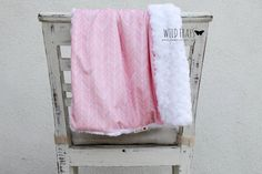 "1 small ""featherland pink/white"" baby blanket {size 24""x31""} with an ivory rosette backing"