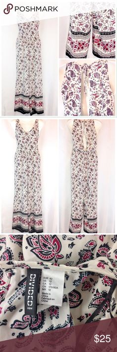 "Divided H&M Paisley Print Jumpsuit Size 12 EUC Excellent condition! Gorgeous Divided cream jumpsuit with black and pink paisley print. Lightweight, cool, 100% Rayon. Halter style tie top with partially open back. Elastic at waist. Size 12. Bust 17"" across. Length 59"".  Please ask all questions before you purchase!  Sorry, no trades or holds. Please use Offer Button! Bundle for best prices! Divided Pants Jumpsuits & Rompers"