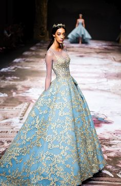 Michael Cinco's Fall/Winter 2017 couture collection tells the story of Versailles, France's most famous and grand baroque palace, through shades of gold, blue and green, and floral embroidery, reminiscent of the château's gardens and palace's courtiers in all their crystal-covered finery. {Facebook and Instagram: The Wedding Scoop}