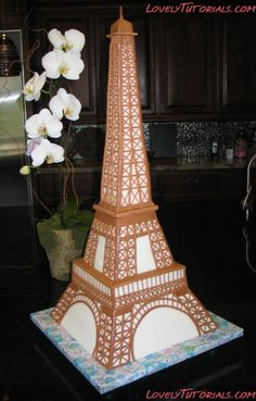 Eiffel Tower Cake - The base is 12 inches square and the overall height is 30 inches. There are 6 layers of cake in the lower 12 inches of this fondant covered cake. All of the tower elements were added by adhering brown fondant strips to the cake. Cake Decorating Techniques, Cake Decorating Tutorials, Fondant Cakes, Cupcake Cakes, 3d Cakes, Eiffel Tower Cake, Paris Cakes, Sculpted Cakes, Cake Cover