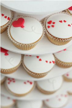 Cupcakes. White. Red hearts.