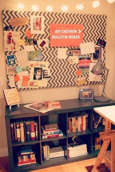 Tons of cork boards put together with fabric on top - covers up white wall.