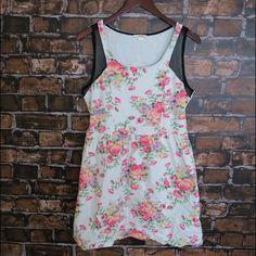 Floral sleeveless skater dress Brand: Timing Size:L New Off white   Sleeveless  Tank  Elastic waist band  Pull over No zipper/pockets  Mesh panels  95% Cotton 5% Spandex No Trade Dresses