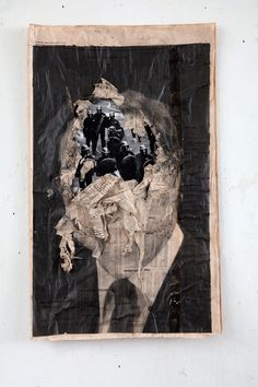 kennardphillipps Study of a Head VII 2013, pigment ink and mixed media on newspaper, framed in bespoke hand made black box frame, 36 x 68 cm By utilizing deprived materials such as newsprint, charcoal and ink, the artists have ripped away at layers to reveal the 'destruction of the welfare state'.