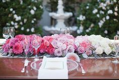 Pink ombre type sweetheart table flowers