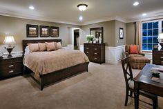 Big beautiful master bedroom. love the pictures above bed, wall two-tone, desk in bedroom