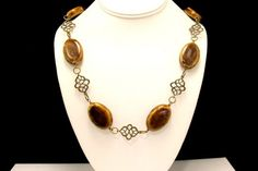 This necklace combines warm, golden brown, porcelain beads with exotic, antique brass connectors to create a chunky and warm piece. It measures 22 inches long.   I stand behind all of my work. If you