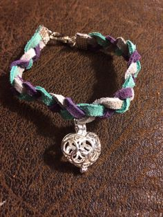 Childs braided leather essential oil diffuser bracelet in turquoise, gray and purple with heart pendant. Simply place a drop or two of the