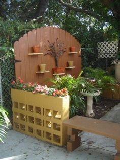 planter wall from painted concrete blocks outdoor wall backdrop from double gates, an option for when I tear out the bbq and need to keep the kids safe on the deck. Nice temporary solution.