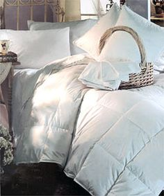 "White REAL down comforter! Organic material, so it's healthier for your body as you sleep, and is ""breathable"" so you don't get too hot or too cold at night...My favorite way to catch my zzz's ( after drinking my ""Isa tea"" of course:) www.montanavictory.isagenix.com"