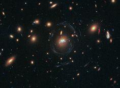 A Blue Bridge of Stars between Cluster Galaxies Image Credit: NASA, ESA, G. Tremblay (ESO) et al.; Acknowledgment: Hubble Heritage Team (STScI/AURA) - ESA/Hubble Collaboration