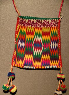This dazzling woven bag comes from a Tepehuano community in Durango Mexico. Exhibited with the Zuno de Echeverria doll collection. Museum of Popular Art, Mexico City