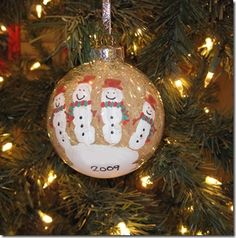 handprint snowmen on clear ornaments then fill them with tinsel. So pretty. these might be out ornaments this year.