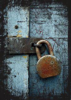 Old rusty lock against blue door