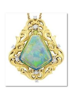 Antique Gold, Platinum, Opal, Diamond and Enamel Pendant, Shreve, Crump & Low Co., with Chain. The shield-shaped pendant composed of pierced scroll and garland design, accented by 8 round and old European-cut diamonds, centring one modified shield-shaped opal approximately 23.0 x 19.0 x 5.4 mm., framed by green and blue enamel, completed by a 14 kt. gold chain, pendant signed S, C & L Co., circa 1900 #OpalPendants #OpalJewelry