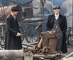 A welcome break: Cillian Murphy relaxes between takes on the set of Peaky Blinders... http://dailym.ai/1mD2VJL#i-51cc0d13