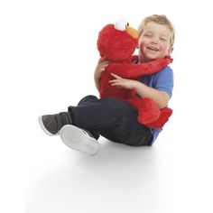 Playskool Sesame Street Big Hugs Elmo really hugs back! Children love this life size (kid sized) Elmo that they can pretend with and once they lay him down, he gets sleepy and sings a lullaby. Elmo Toys, Best Christmas Toys, Elmo Christmas, Christmas Gifts, Holiday, Christmas Ideas, Christmas 2014, Christmas Shopping, Elmo Sesame Street