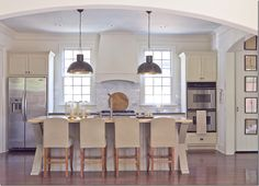 Like the symmetry & clean lines to this kitchen, but is this all there is? Doesn't appear to have enough storage.