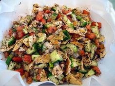 My fav salad! Fatoush is a traditional Lebanese salad made with ripe tomatoes, cucumbers, romaine lettuce, onions, green onions, mint, parsley, fresh squeezed lemon juice, well mashed garlic, extra virgin olive oil, thinly sliced radish, bell peppers and the most important additions that make this salad Fatoush...sumac and toasted pita bread.