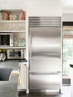 """I wonder how this kitchen is actually layed out? """"Free Up Space   PREV  5/24  NEXT  Free Up Space  A firm believer in open storage, the homeowner uses shelves to keep everyday items easy to see and reach. Shelves next to the refrigerator hold the microwave and wine cooler; the latter frees up space in the fridge."""""""