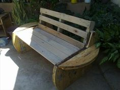rustic yet modern pallet and wire spool sofa