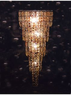 Chandelier made from over a 1,000 discarded or defective eyeglasses by stuart haygrath.