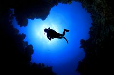 """The 10 Most Dangerous SCUBA Dives in the World-Eagle's Nest Sinkhole—Weeki Wachee, Fla.  Eagle's Nest begins with a narrow tunnel that takes divers down about 70 feet into """"the main ballroom"""", a vast chamber that leads to small dark passages, which in some spots reach 300 feet deep. Total darkness and extreme depths combine with the complicated cave network to create a dangerous diving experience. Several have lost their lives."""