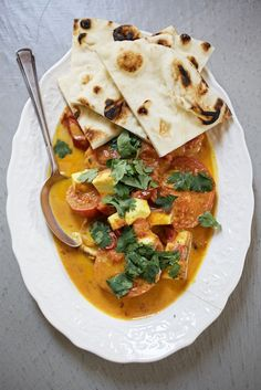 Paneer and Tomato Curry. Not the healthiest recipe, especially if you use the paneer, but man is it delicious. You can also sub the paneer for tofu (yuck) or yukon gold potatoes (yum) Indian Food Recipes, Asian Recipes, Vegetarian Recipes, Cooking Recipes, Healthy Recipes, Great Recipes, Favorite Recipes, Yummy Recipes, Tomato Curry
