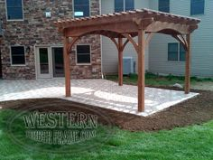 Free standing pergola with Early American stain and Roosevelt profile. Upgraded arched beams.