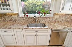 Granite countertops have become the staple of a high-quality kitchen.Though only one of many countertops, granite countertop prices are Affordable. White Granite Countertops, Granite Backsplash, Granite Kitchen, Kitchen Countertops, Kitchen Cabinets, White Cabinets, Kitchen Backsplash, Kitchen Sink, Eclectic Kitchen