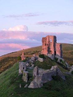 The ruins at sunset - Corfe Castle, Dorset, UK ~ The castle stands above the village and dates back in some form to the 10th century. It was the site of the murder of Edward the Martyr in 978. During the English Civil War it was a Royalist stronghold and was besieged twice, in 1643 and again in 1646. It is currently owned by the National Trust and is open to the public. by Ana Oliva