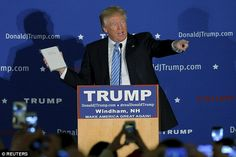 Donald Trump holds a Bible given to him by an audience member at a campaign rally in Windham, New Hampshire, on Monday