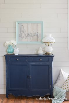 Custom painted navy sofa table with Naval by Benjamin Moore