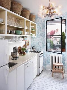 Urban Retro Kitchen Design - Love it all but the wallpaper and that light! The wall could be blue, or pale yellow (butter-cream) and maybe some sort of metal industrial light fixture for fun.  Floor is awesome, love the shelving and baskets.