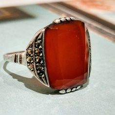Slick chick Art Deco ring.  Sterling Silver, Carnelian cushion cut, and Marcasite ring from the 1920s.  Want to see more?  https://www.etsy.com/listing/537985560/red-jewelry-wife-marsala-1920-gatsby . . #slick #geometricjewelry #slickchick #chicjewelry #a