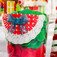 Make a delish container of holiday-hued candy even cuter with a DIY bunting! Click the pic for the easy-peasy how-to and more Christmas party ideas.