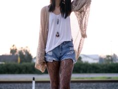 love the textured tights with the jean shorts + sweater