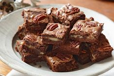 Caramel-Pecan Brownies recipe - Gooey chocolate, melty caramel, crunchy pecans…this may be the ultimate pan of brownies. Just one of these squares packs enough chocolate punch to satisfy your snacking mood. #brownies