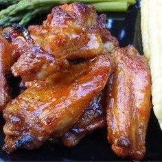 These detroit style wings are honey glazed as they grill and tossed with a sweet and spicy sauce right off the heat. challenge your friends with more cayenne and hot sauce, or pull back the heat and serve with a blue cheese dressing to calm the fire! Honey Wings, Spicy Wings, Bbq Wings, Great Recipes, Favorite Recipes, Honey Recipes, Popular Recipes, Sweet And Spicy Sauce, Tasty