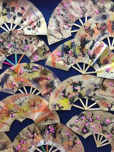 Japanese fan craft. Made with: Popsicle sticks, brown paper, covered in leaf rubbings, ink blowing and scrunched tissue paper to create a cherry blossom effect.