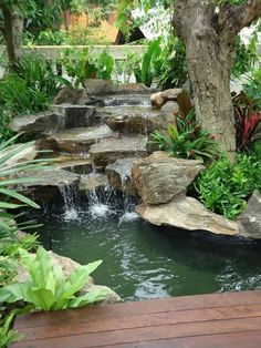 It's not difficult to create a waterfall pond feature rather than the conventional pond. With this small waterfall pond landscaping ideas you will inspired to make your own small waterfall on your home backyard. Pond Landscaping, Ponds Backyard, Backyard Waterfalls, Waterfall Landscaping, Garden Ponds, Backyard Ideas, Koi Ponds, Landscaping Design, Water Falls Backyard