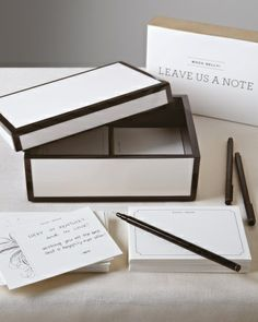 A card-and-lacquer-box station for guests' well-wishes