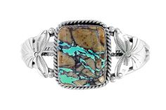 This is a Native American handmade Boulder Turquoise bracelet in sterling silver. Boulder Turquoise is also called Royston Ribbon turquoise because it comes fro