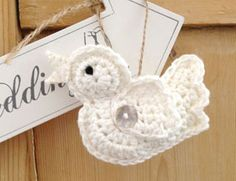 Cream and white handmade crochet wedding birds. Available to order direct from Ruby and Custard. Perfect for adding vintage wedding style.