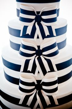 Black and white striped Wedding cake with bows! Love this cake!