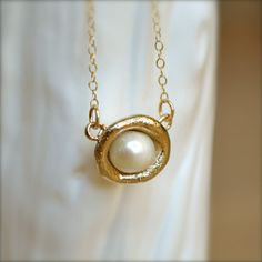 Hey, I found this really awesome Etsy listing at http://www.etsy.com/listing/99514033/pearl-cup-gold-necklace