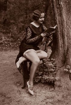 It's weird how many pictures there are of flappers reading.
