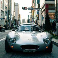 Looks like a Jaguar D type with a hard top.. the raised fenders definitely rule out an E-type.